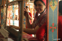 Uzbek woman weaving silk at Yodgorlik silk factory in Margilan, Uzbekistan