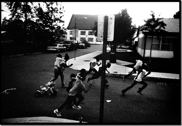 Children racing down the street in the William Penn housing projects, which is notorious for being one of the most violent areas in the city. Justin Maxon