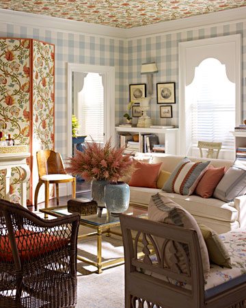 I designed this pattern-filled room as part of a decorating face-off between Rebecca Robertson and me. This gingham pattern by Schumacher has oversize checks that are bold rather than sweet. The more contemporary scale of the check allowed for adding florals without causing the room to feel stiff.