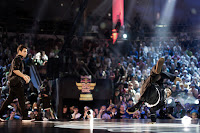Roxrite (R) of USA performs as Lil G (L) of Venezuela watches on during the Red Bull BC One breakdancing world finals at the Circus Nikulin in Moscow, Russian Federation on November 26, 2011.