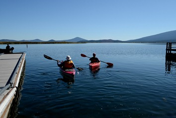 Laurie and Odel taking off in the kayaks for the first time