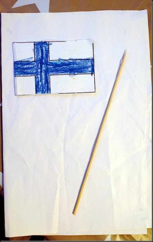 askartele lippu joki jäässä 003