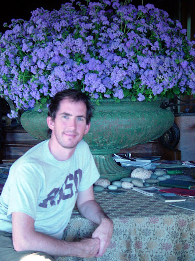 Me in front of an outdoor garden urn that I filled with ageratum, which Martha brought inside.