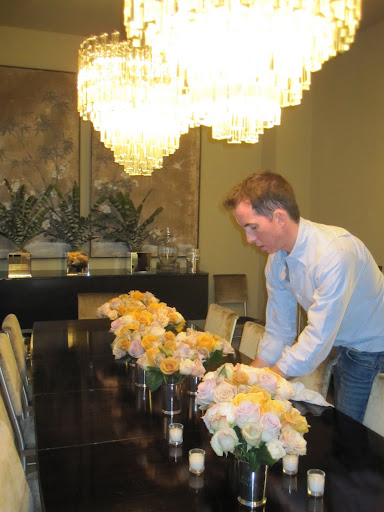 here I am making sure the flowers are arranged in the best way on my dining room table.