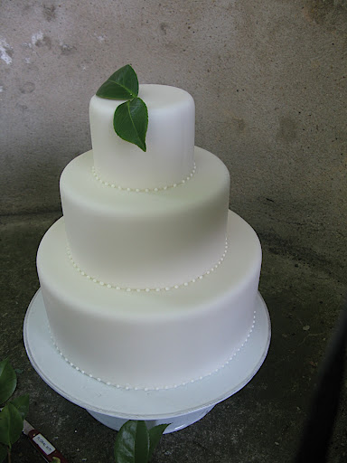 We propped it up on a cake stand, and then added flowers and foliage for a bit of color.