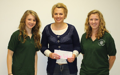 Christina Waters received a donation County Council vice president, Lexi Marek and president, Sarah Altenhofen presented the check to Waters.  Photo Courtesy:  Washington County Extension.