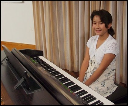 """Hana Tani played our Clavinova CVP-509. Hana is a young lady of 9 years who has been playing for about 3 years and chose to play for us """"Romanian Folk Dance"""" in six movements. Executed beautifully as well - amazing. Good luck with your upcoming competition Hana. Photo courtesy of Dennis Lyons."""