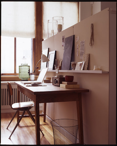 Desks are other places that accumulate clutter easily.  A small picture ledge hung above is perfect for keeping accessories in reach and off your work surface.