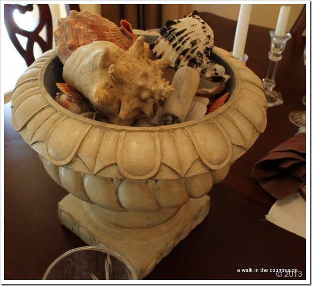 seashells in urn as centerpiece