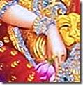 Sita Devi holding a flower