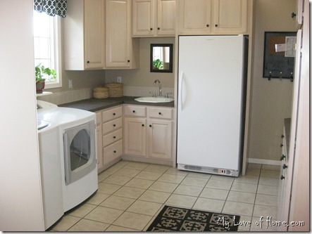 beige black laundry room white washer dryer black rug