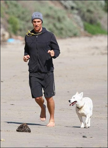 Matthew McConaughey jogs on the beach with his dog, B.J., on a Sunday morning in Malibu, Calif.