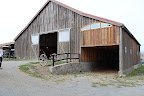 Their amazing barn. Can't you just picture huge drapes of fabric hung up over the entrance?