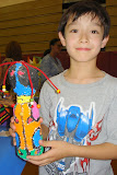 Kai showing off his creation at the Haverford art show for all the district's elementary schools