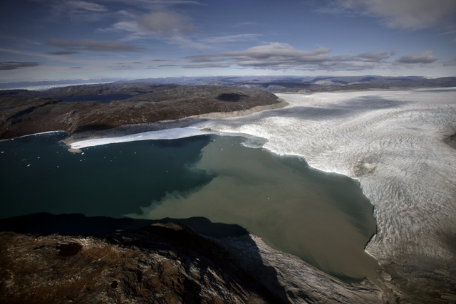 Where ice once capped the Sermeq Avangnardleq glacier in Greenland, vast expanses of the Arctic Ocean are now clear. Photo: Kadir van Lohuizen / The New York Times