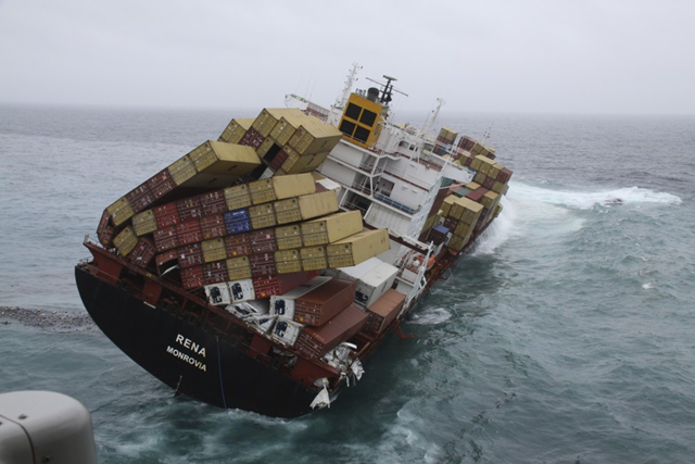 The 47,230 tonne Costamare-owned MV Rena lists in heavy swells, about 12 nautical miles (22 km) from Tauranga, on the east coast of New Zealand's North Island, 12 October 2011, a week after hitting the Astrolabe Reef. Reuters