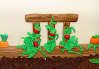Trellis and tomatoes on side of cake