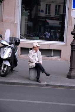 Sitting on a bollard