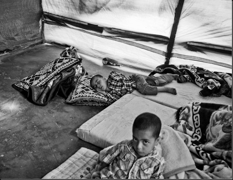 Syrian children inside their family's tent in a settlement in the Bekaa Valley, Lebanon. (Moises Saman/Magnum Photos for Save the Children)