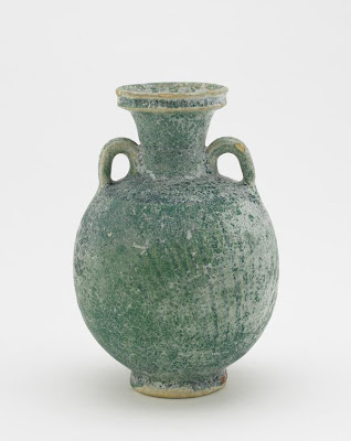 Rakka type ware bottle | Origin:  Iraq | Period: 11th-12th century | Details:  Not Available | Type: Earthenware with turquoise alkali-silicate glaze colored by copper | Size: H: 16.6  W: 11.2  cm | Museum Code: F1910.26 | Photograph and description taken from Freer and the Sackler (Smithsonian) Museums.