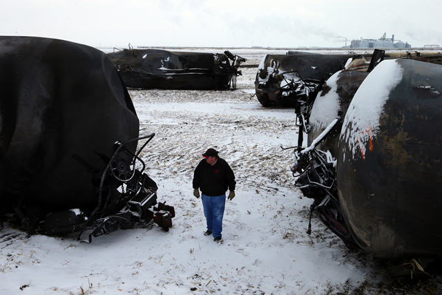 Ed McConnell, the mayor of Casselton, N.D., inspects the burned oil tank cars after a fiery rail accident in December 2013 only a half mile down the tracks, which prompted residents to evacuate the town. Photo: Jim Wilson / The New York Times