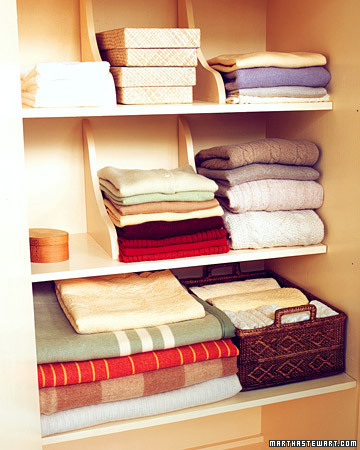 Keep stacks of folded sweaters and other clothes from toppling by using shelf brackets. http://www.marthastewart.com/273392/add-brackets-for-neat-stacks