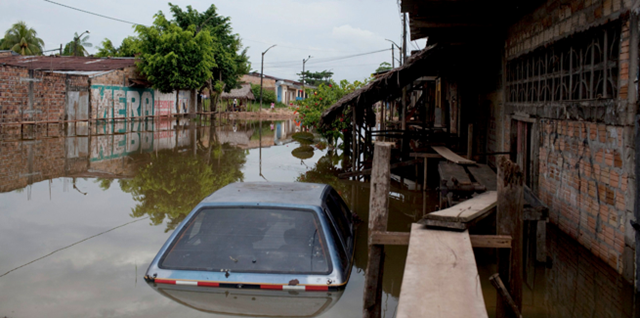 A flooded street in Peru, April 2012. More than 200,000 people have been displaced by recent flooding in Peru, and many sources of clean drinking water have been compromised. Water Missions International