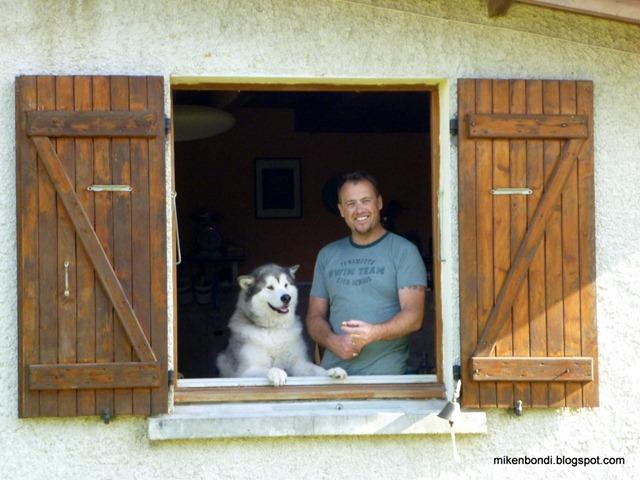 Mike & Munson at kitchen window