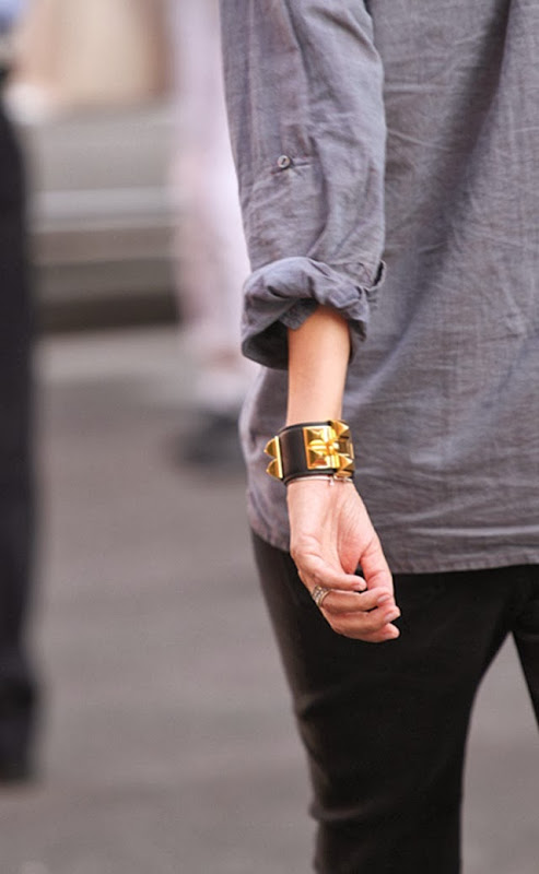 girl on the street casual outfit and gold pyramid studded black leather bracelet