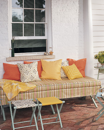 I love the way the bright colors complement this casual furniture.  (marthastewart.com)