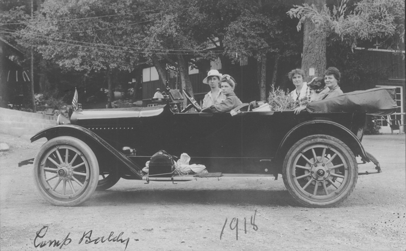 Dorothy Putnam driving car of women at Camp Baldy. Putnum was the first licensed female chauffeur in California. 1918.