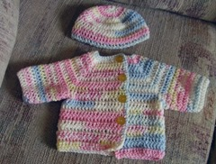 Sweater set blues pinks yellows