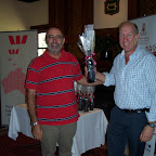 Fred Hamood presenting the 'nearest the pin' prize of O'Leary Walker Wine to John Easling