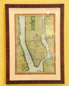 The antique look of this framed map was achieved through dying the map with tea. (marthastewart.com)