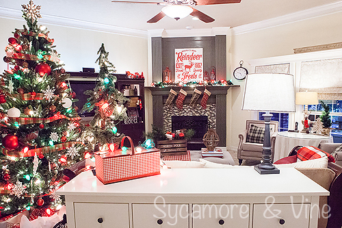 A living room decorated around the plaid Country Christmas theme. A truly stunning Christmas Home Tour as part of the Christmas in the Country Blog Tour. This Plaid Inspired Country Christmas will knock your socks off. Features tours of the Living room, Dining Room and a Cocoa hot chocolate bar in the Breakfast room. There is so much inspiration for Christmas decorations in this one post. Be prepared to feel like you are cuddled up by the fire in a warm Northwoods comfy cottage! #country #Christmas #Plaid #Holiday decorating #Holiday ideas #Holidays #Christmas decor #Holiday decor
