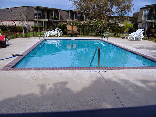 This apartment complex pool offers all the safety features that go along with a commercial pool, which includes safety grip coping, handrails and ladders and depth markers.