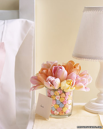 This arrangement speaks for itself. Pastel candy hearts pair nicely with tulips in complementary colors.