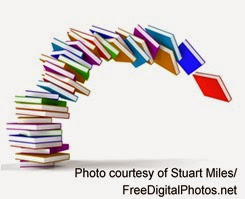 Tilting tower of books with attribution 2