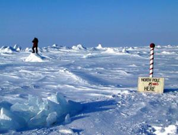 A sign in the Arctic reads, 'North Pole was here'. Climate change is causing the North Pole's location to drift, owing to subtle changes in Earth's rotation that result from the melting of glaciers and ice sheets. Photo: Andrew C. Revkin/eyevine