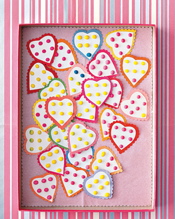 Candy buttons cut in the shape of a heart will fit perfectly in an envelope.