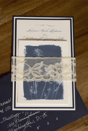 The invites were bound with lace trim.