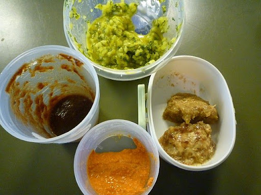 clockwise from top Pickle Relish, Date-Mayo, Mustard-Chutney, Romesco, Spicy and Sweet Tamarind Sauce