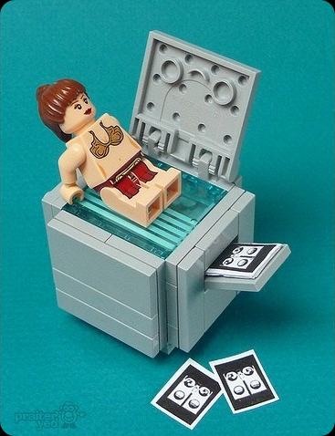 Naughty Lego Princess Leia In A Bikini sitting on a photocopier making butt prints
