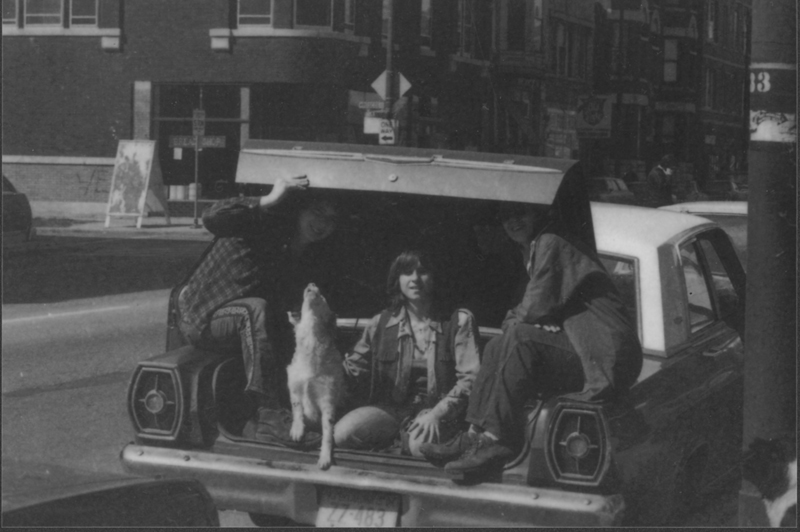 Three lesbians and their dog, who travelled from Oklahoma to attend the First National Lesbian Conference, UCLA, gather in the trunk of their car to wait out the Los Angeles sun. April 1973.