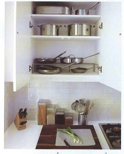 You can see my pots and pans on the rack in the cabinet. It's much easier for me to access what I need.