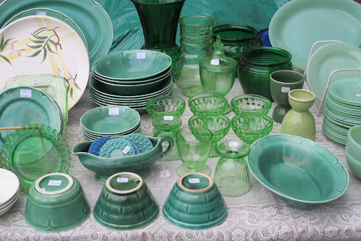Green pottery and Depression glass was displayed on an antique lace tablecloth. The jadite (on the right) has always been a favorite of Martha's.