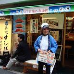 lady holding a sushi menu at tsukiji fishmarket in tokyo in Ginza, Tokyo, Japan
