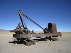 The remnants of an ancient steam crane. Now just parked out in the desert near the cemetery.