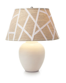 Use crisscrossed lengths of twill tape to turn a plain linen shade into a striking graphic one. (marthastewart.com)