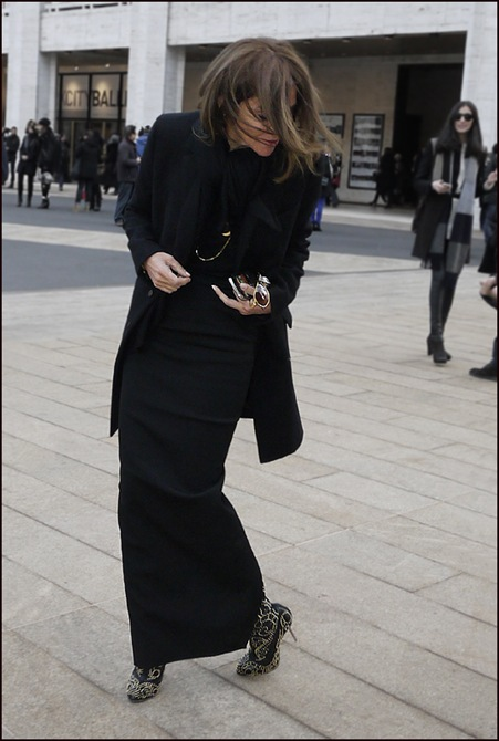 Carine Roitfeld showing black studded boots ol